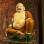 Photo of a smiling buddah statue