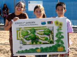 students holding up rendered design of Firefly Garden